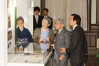 Their Majesties the Emperor and Empress looking at the displays, Ms. Tae Koizumi at far left