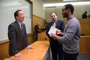 President Seike talking to a member of the audience after the lecture (Photo: Martha Stewart)